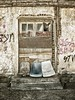 Three's a Crowd (Blues Views) Tags: urban olympuspenep3 sigma19mmf28artlens decay chairs thessalonikigreece thessalonikistreet graffiti brick door doorway
