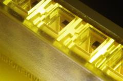 Harmonica Light Show (erluko) Tags: macromondays memberschoicemusicalinstruments harmonica light lighting music instrument song blues toy harp madeinchina lit detail macro closeup yellow texture