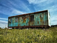 From the archives... A rusted Soviet-era caravan. Almaty region, Kazakhstan. ca. 2013 (isaacullah) Tags: kazakhstan caravan blue grass rust travel soviet asia