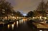 Amsterdam. (alamsterdam) Tags: amsterdam canal brouwersgracht clouds longexposure evening reflection bridge houseboats tug footbridge