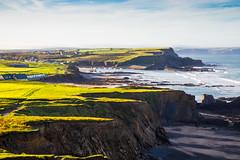 Light on the hill (JRPics.) Tags: grass shadow uk sunshine canon5dmk4 sea nature mist cornwall rocks outside september coast cliff waves