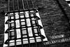 Bars (JCTopping) Tags: holland 6d 50mm netherlands egelantiersgracht dark brick window centrum canon blackandwhite amsterdam bars noordholland nl