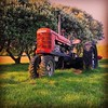 Big Red (Psychic Insights) Tags: grass trees playgrounds tractors red orange green outdoors stages life fun enjoyment happy playing