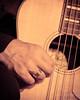 Husband Blues (Isuru Jayasuriya) Tags: guitar finger ring married music closeup nikon d610 70200 fl play man strings instrument hand details fender kingman orange gold string playing black shirt sleeve white
