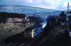 Meanwhile oop norf and prior to sprinterisation....things were much better....proper trains....47592 County of Avon 10-53 Scarborough-Holyhead nr Stalybridge  28-02-1987 (the.chair) Tags: 47592 county avon 1053 scarborughholyhead nr feb 1987 stalybridge