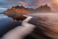 Walk the line (inkasinclair) Tags: vestrahorn sunrise mountains mountain golden hour iceland stokness waves water motion glow sun clouds ocean batman autumn landscape nature alone walk line leading nikon d810