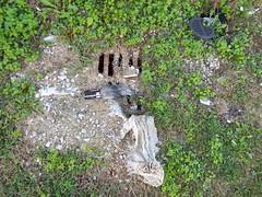 Plastic Bottle (EX22218 - ON/OFF) Tags: plastic trash bottle weed weeds stone stones drainage waterline siltfence rabbitsalad infrastructure
