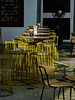 A Table Light (Steve Taylor (Photography)) Tags: happyhour 1for1 clarkequay menu fan chair cafe table tableandchairs restaurant yellow asia city singapore juxtaposition sunny sunshine shadow