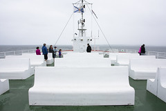 """""""Basic, Gross, and Charming"""" (Loops666) Tags: bench ferry boat ship seats lounge deck green white transportation passengers people flag novascotia pei ocean northumberlandstrait canada"""