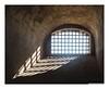 Window Light (Rory Prior) Tags: europe italy naples autumm bars castle light sun sunny vomero window elmo