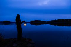 with lantern on the shore of a lake (VisitLakeland) Tags: finland lakeland lake autumn syksy järvi water vesi scenery scene näkymä kuopiotahko reflection heijastus mirror peilikuva night yö yötaivas sky blue sininen silhouette siluetti shadow varjo