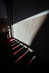 Cutting Stairs (Thomas Listl) Tags: thomaslistl color diagonal contrast light shadows staircase stairs red door house 14mm ultrawideangle wideangle graphical geometry