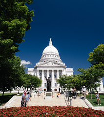 fair madison (almostsummersky) Tags: madison capitolsquare capitol building crowd center windows dome red stairs trees columns urban flowers statue blue cloud wisconsin government architecture green sky forward granite downtown unitedstates us