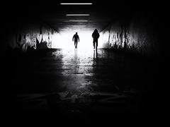 out of the darkness (Sandy...J) Tags: olympus monochrom man people photography urban underpass atmosphere light darkness silhouette city walking blackwhite bw black germany noir street streetphotography