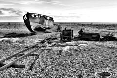 Decaying Boat (Croydon Clicker) Tags: boat monochrome blackwhite rails sky sea shingle beach nikon35mmf18prime nikond5500 1000v40f