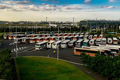 Haneda Bus Parking (RW Sinclair) Tags: 2017 asia autumn fall japan october sony a6000 alpha csc digital milc mirrorless tokyo color 東京 日本 旅 haneda hnd airport americanairlines bus parking lot clouds sky