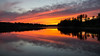 Sunset (Stefano Rugolo) Tags: stefanorugolo pentax k5 smcpentaxda1855mmf3556alwr sunset lake reflection silhouettes sky clouds hälsingland sweden sverige 169 water wood tree serene dusk colors