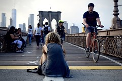 In the Moment (-»james•stave«-) Tags: newyork nyc brooklyn city street urban brooklynbridge pedestrian walkway bicycles path bike lane people seated back woman sitting meditate downtime zone boundary territory yellowline onthefrontline nikon d5300
