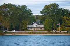 Fine Location for a Beautiful House (Herculeus.) Tags: 2017 architecture buildings day fences islandsmackinacisland landscape landscapes mi oct outdoor outdoors outside picketfence porch residences sfhomes shoreline spring strait straitofmackinac sunset sunsetcruise water usa sky building woodenhouses