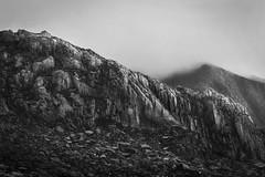 Rock face (richcaulton) Tags: rock quarry face mountain boulder bouldering boulders climbing mono black white clouds fog wales nikon