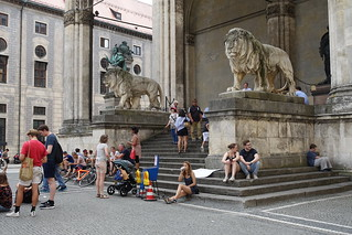people and stone lions