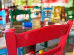 Funky chairs (Karsten Gieselmann) Tags: 1240mmf28 blau chalkidiki em5markii einrichtung europa gelb greece griechenland grün jahreszeiten mzuiko microfourthirds möbel olympus reise rot sommer stuhl blue chair furniture green kgiesel m43 mft red seasons summer travel yellow sarti karpouzaki