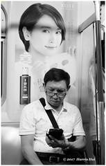 Beautification Is Big Business - Hong Kong XT4859e (Harris Hui (in search of light)) Tags: harrishui fujixt1 digitalmirrorlesscamera fuji fujifilm vancouver richmond bc canada vancouverdslrshooter mirrorless fujixambassador xt1 fujixcamera fujixseries fujix fuji35mmf2 fujiprimelens fixedlens subway beautifcation beautify street candid streetphotography cellphone cellphoneuser mtr hongkong advertisement