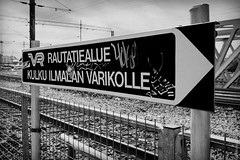Railway Station On The VR Commuter Rail (thedot_ru) Tags: ilmala railway station vr helsinki finland travel adventure sign graffiti streetart art sticker tags blackandwhite bw canon20d 2005