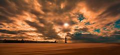 Storm Brewing over Lighthouse (John Tymon) Tags: sky fire lighthouse newbrighton perchrock sunset