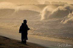 Fisherman by the by the Angry Sea (Jose Matutina) Tags: california fisherman newportbeach ocean orangecounty sea silhouette waves