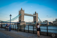 """"""" chimping """" or reviewing the day's captures.. (Davos Pessos) Tags: londonmetropolis towerbridge tourist toweroflondon lady sky streetphotography dolphinsculpture backpacker riverthames riverferry riverbarge water architecture londonhistory city moon redbus"""