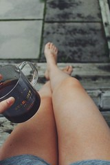 Morning Coffee (bethanyjaynew) Tags: morning summer tan coffee starbucks mug glass outdoors outside nature girl feet long legs gold transparent mornings caffeine green grey gray perspective drink tired sleep canon rebel focus portrait mode wakeup cafe relax starbuckscoffee morningcoffee texture depthoffield latte