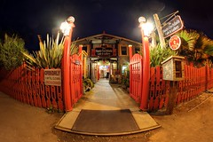 Open till closing (PeterThoeny) Tags: mosslanding california hauteenchiladacafe cafe restaurant outdoor gate entrance red fence redfence light night sony sonya7 a7 a7ii a7mii alpha7mii ilce7m2 fullframe rokinon12mm rokinon12mmf28 samyang12mm samyang12mmf28 ultrawidefisheyelens fisheyelens fisheye wideangle 1xp raw photomatix hdr qualityhdr qualityhdrphotography fav100