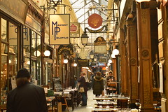 Passage des Panoramos (fletcherd5) Tags: carvings wood clock blackboard glasses tables table restaurant cafes cafe bistro shoppers tourists shopping wroughtironsigns signs sign antiqueshops antiques shops shop france paris passagedespanoramos