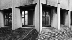 (Delay Tactics) Tags: doncaster court concrete windows corner angles black white bw slope cobbles brutal brutalist brutalism film red october oktober 169 16x9