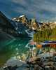 At Peace (Betty Hodges) Tags: canoe lakelouise trees banffnationalpark sunrise alberta rocks rockies water mountains sky reflections lake clouds morainelake snow