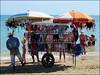Saldi di fine stagione (Maulamb) Tags: ambulante bikini carretto ombrelloni