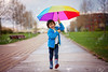 Cute little boy, walking in a park on a rainy day, playing and jumping, smiling (hoangngaunguyen) Tags: rain sunlight jumping baby fun park spring autumn boy trees field happiness parasol walking positivity umbrella people love colored smile expressing young colorful adorable beauty childhood rural outdoors boots resting kid trunk emotions scene beautiful path child exercise nature rainbow idyllic little casualclothing nonurban water grass