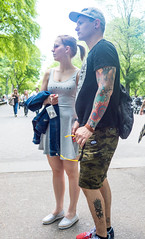 Minimalism (UrbanphotoZ) Tags: couple man woman minimalism tanktop ponytail shorts cap tattoos arm leg camouflage shades camera jacket centralpark themall pedestrians trees manhattan newyorkcity newyork nyc ny