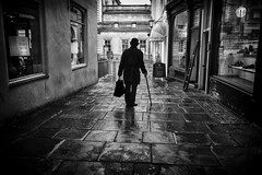 the man in the bowler hat (Daz Smith) Tags: dazsmith fujixt20 fuji xt20 andwhite bath city streetphotography people candid portrait citylife thecity urban streets uk monochrome blancoynegro blackandwhite mono bowlerhat bag walkingstick cane silhouette absoluteblackandwhite