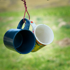 Cups (*Jilltoo) Tags: cups two square hanging tied wire outdoors picnic utata:project=ip257