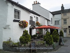 Wordsworth's Hawkshead (john shortland) Tags: lakedistrict nationalpark lancashire pub inn wiliamwordsworth poet theprelude begonias hangingbasket flowers annual drystonewall thekingsarms hawkshead village umbrella outdoors building publichouse dwarf conifer elizabethan
