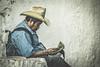 Chichicastenango (gies777) Tags: guatemala chichicastenango zentralamerika mittelamerika lateinamerika central america mann man sony dslr a700 alpha zeitung paper lesen reading hut sombrero hat