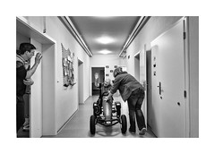 Pedal car (Jan Dobrovsky) Tags: leicaq contrast leica monochrome care indoor people reallife blackandwhite grain mentallyhandicapped human northernbohemia document