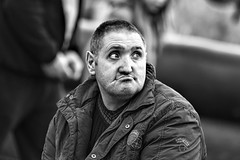 Giving his complete attention (Frank Fullard) Tags: frankfullard fullard candid street portrait face monochrome blackandwhite mohill leitrim irish ireland serious eyes concentration attention horsefair