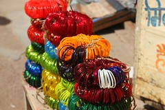 Khajuraho,  Colours in the Market (Heaven`s Gate (John)) Tags: khajuraho monument india colour color market fabric sunshine plastic rings