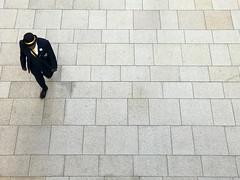 Information (paul indigo) Tags: paulindigo aerial bowlerhat colour graphic horizontal information man official pavement people streetphotography uniform walking