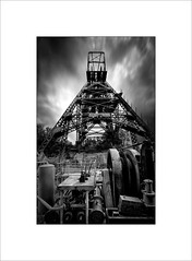 Pit head 2 (tkimages2011) Tags: pit head astley lancashire mining museum symmetry triangle industrial industry old decay entropy machinery engineering mono monochrome outside sky le longexposure