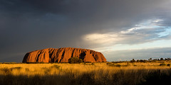 Uluru at Sundown (armct) Tags: spinifex desert sundown sunset sky cloud storm uluru arid blue rock ayersrock australia central contours weathering