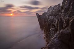 On the back of a sleeping dragon. (Emykla) Tags: drago dragon sea sunset tramonto mare sicilia sicily italia italy nikon d3100 sole sun nuvole clouds water acqua rocks rocce scogli